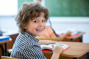 Boy smiling at school